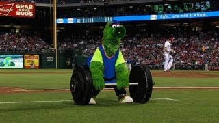 A young fan ONE-UPS the Phillie Phanatic with an overhead press