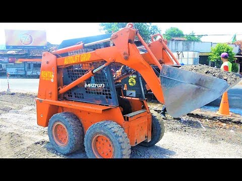 Skid Steer Loader Toyota And Bobcat Working On Road Widening Construction