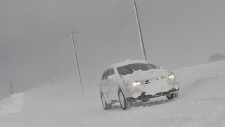 Subaru Outback Deep Snow-Attack white‐out