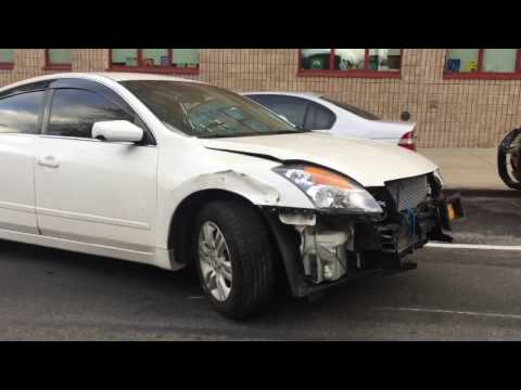 Totaled Nissan driving crazy in Queens