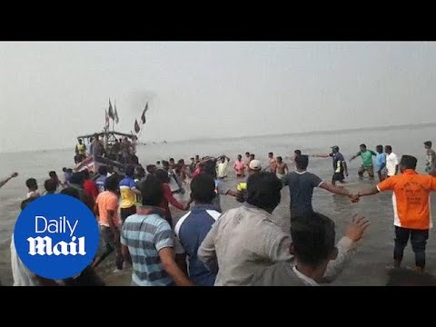 Rescue workers rush to help victims of ferry sinking in India - Daily Mail