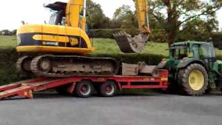 JCB 13t Track Excavator loading onto trailer