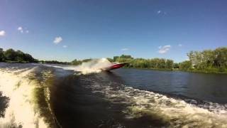 Speedboat Jumps Surf Wake