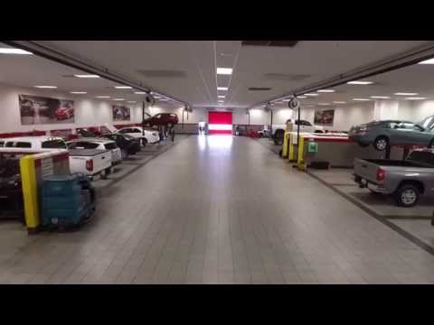 Car dealership repair bay drone flythrough