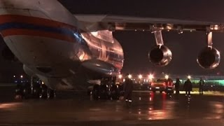 Raw: Remains Of Plane Victims Return to Russia