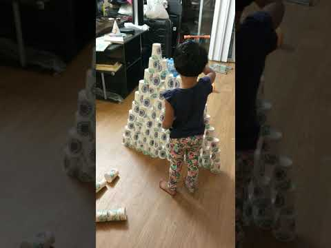 Vedanshi building Pyramid with paper glasses