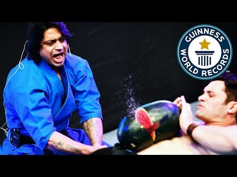 Most watermelons chopped on the stomach in one minute – Guinness World Records