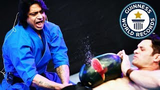 Most watermelons chopped on the stomach in one minute - Guinness World Records