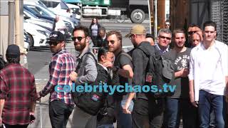 Dierks Bentley waves over to fans outside the Jimmy Kimmel live show