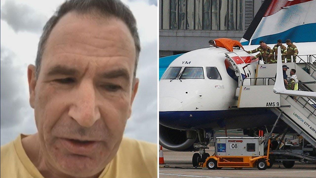 Activist climbs plane as Extinction Rebellion takes protest to London airport ile ilgili görsel sonucu