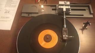 Mitsubishi model LT-20 Linear Tracking Turntable Playing a record