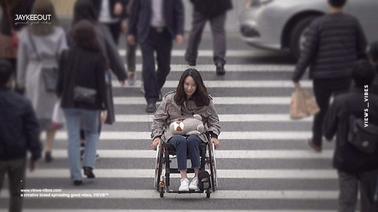 Struggling person in a wheelchair on a crosswalk | Social Experiment