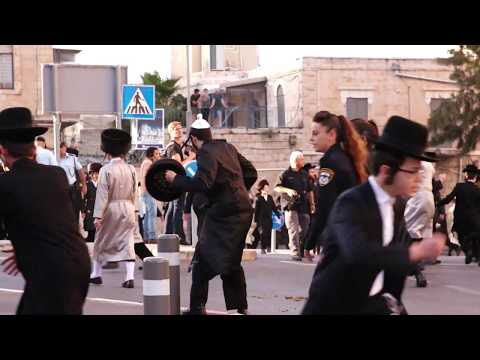 Women In Bras Confront Ultra-Orthodox Jews Protesting Against Eurovision