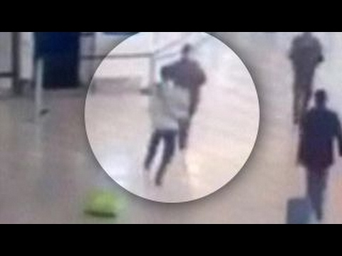Moment man takes soldier hostage at airport caught on tape