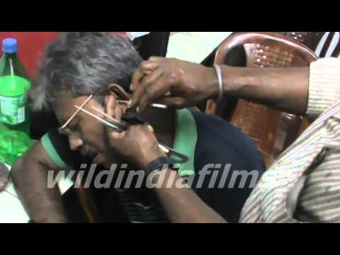Roadside ear wax cleaning in Kolkata , India by wildindiafilms