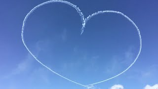 Planes trace a heart with contrails in the sky