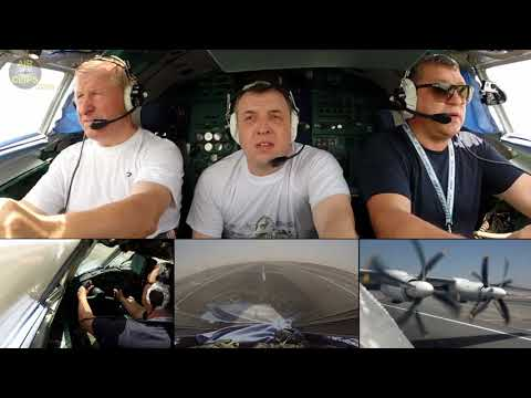 REAL Men at Work:  World's largest Turboprop An-22 lifted up by pure muscles!!! [AirClips]