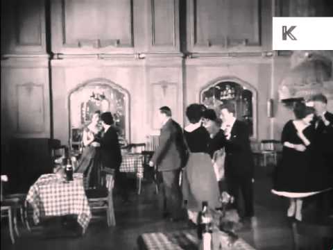 1950s Dance Hall Men And Women Get Up To Dance Rock N