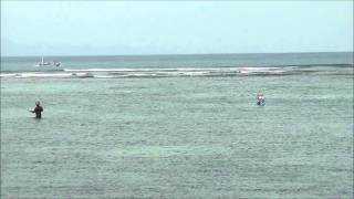 Fishermen in Sanu Beach waters, Bali, Indonesia