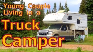 Young Couple in a Truck Camper