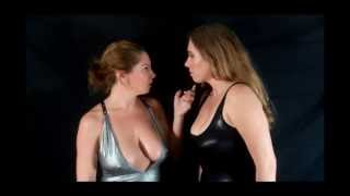 Two beautiful brunettes try to hypnotize each other