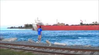 Three lake freighters under the Blue Water Bridge, Port Huron, Michigan