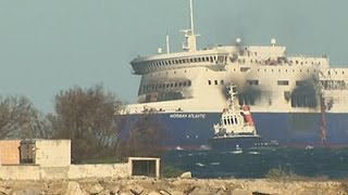 Raw: Charred Greek Ferry Towed to Port in Italy