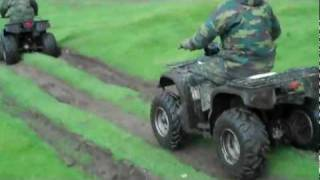 ATV Quad Bikes Jumping in Mud