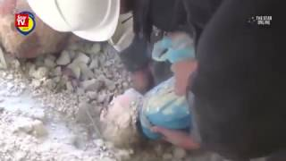 Child pulled out of rubble as air strikes bombard several Syrian cities