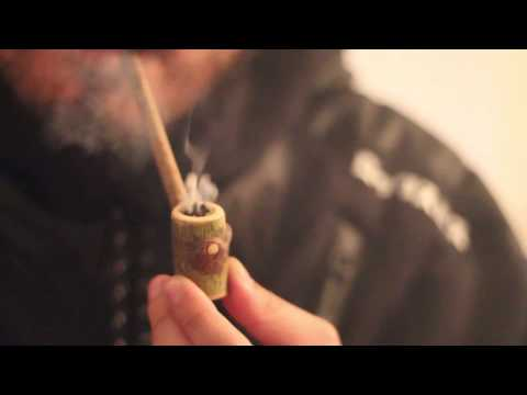 Smoking Out Of A Wooden Pipe and Taking Dabs