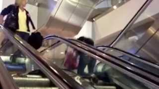 Girl going up the down escalator fail