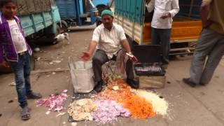 Veg Cutter seller in KR Market area in Bengaluru India