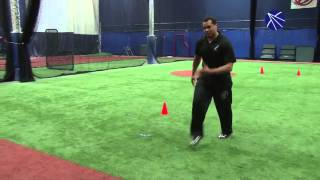 Elite 7 owner and trainer Alex Kube demonstrates how to properly execute the three-cone drill at com