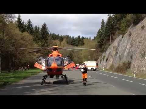 Rescue Services taking injured motorcyclist to a Frankfurt clinic