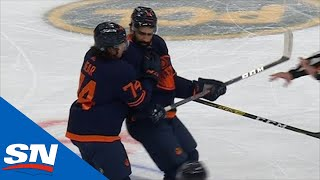 Jujhar Khaira Has Trouble Skating Off After Huge Check From Alexander Romanov