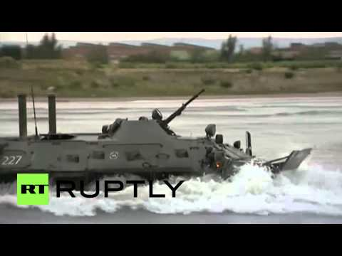 Russia: BTR-80s crash through waters for Centre-2015 mass military drills