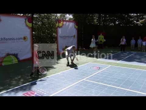 WHITE HOUSE EASTER EGG ROLL:OBAMA PLAYS TENNIS