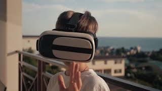 Happy Boy at Sunset, Wearing Virtual Reality Glasses, Playing Video Games Cheerful Smiling, Looking