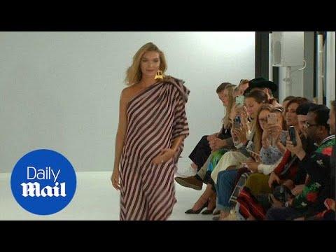 Arizona Muse flashes baby bump on London Fashion Week catwalk