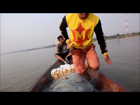 Catching fish by net fishing with cook asian food - Thakhek laos