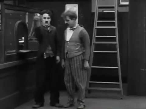 Simon Gregory improvises  to Charlie Chaplin The Pawn Shop on Willis  organ at Ewell.