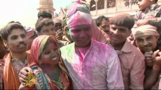 India explodes into color for Holi