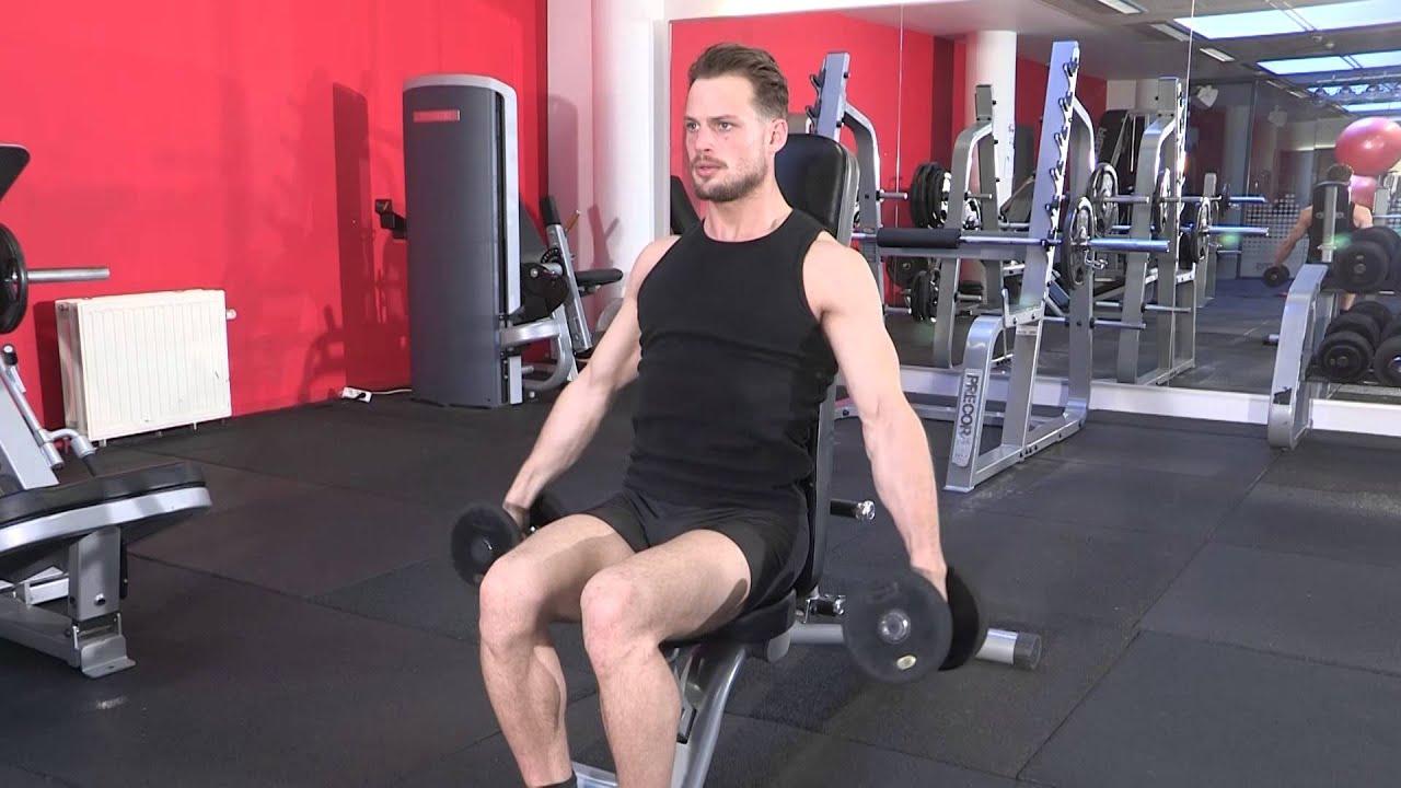 Exercice de musculation épaules - Elévation latérale assis ...