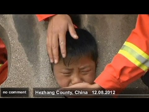 Chinese Boy gets head stuck in guardrail - no comment