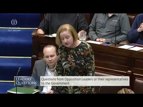 Ruth Coppinger TD holds up Maser repeal sign in Dáil
