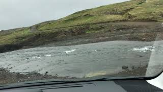 Driving through an F road river, Iceland