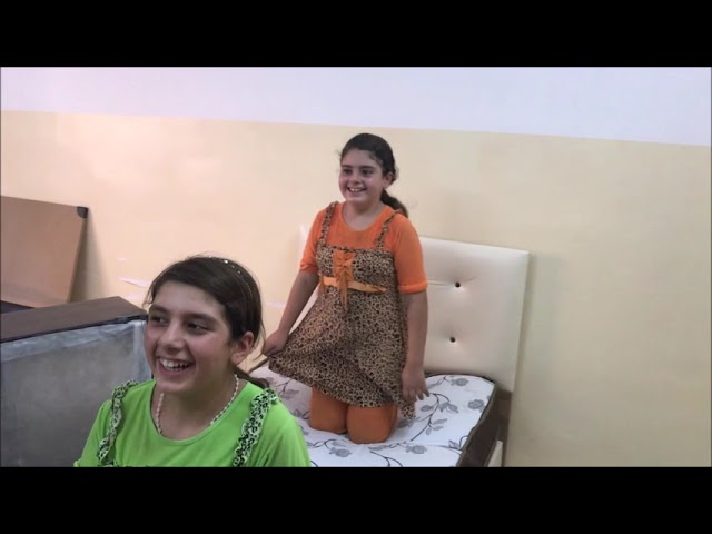 148 - Relocating a Mosul family from a sheep barn to a house