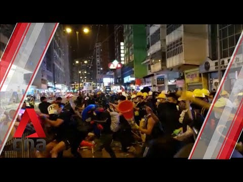 Fight breaks out between group of men with sticks and anti-government protesters in Hong Kong