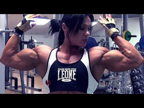 Jay Fuchs big female bodybuilder with huge biceps flex and workout