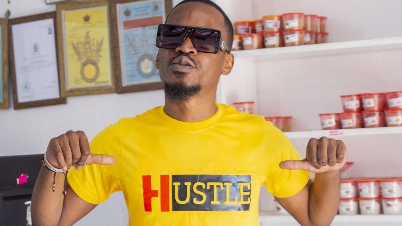 Alaba Naine As I Was Advertising The Hustle T-shirts For Mwizukanji At Nox Buchery.